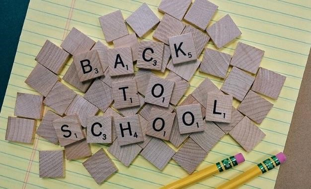 "Scrabble letter tiles arranged to read ""Back to School"""