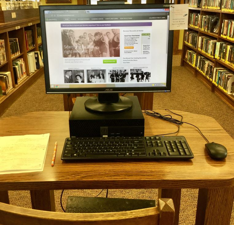 library computer with Ancestry Library Edition on its screen