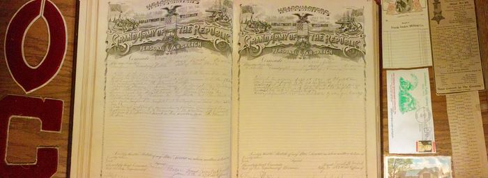 section of old document with a picture of an eagle and a list of the names of Columbia County cadets