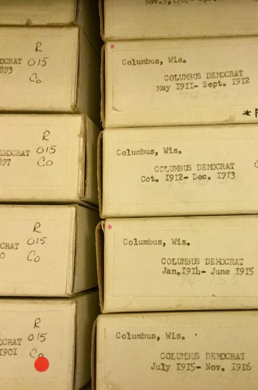panoramic photo of boxed microfilm reels in a drawer
