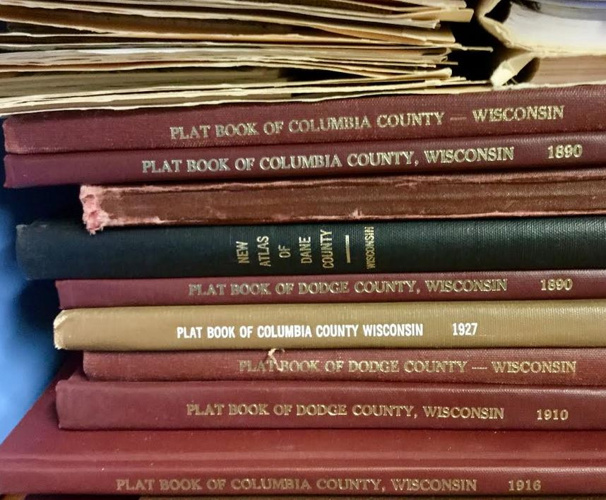 several volumes of historic plat maps