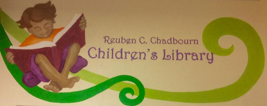 mural depicting a child reading and the inscription Reuben C. Chadbourn Children's Library