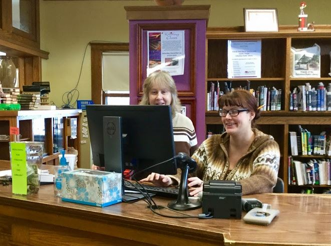 staff members at the library front desk